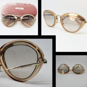 05cd9bda677a Miu Miu Sunglasses Cat Eye Gold Clear Blush